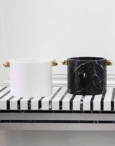 KELLYWEARSTLER   ACOLYTE ICE PAIL. Negro Marquina and White Calacatta marble adorned with hand-picked pyrite cast in bronze