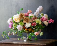 arrangement with flowers and tomatoes...Kiana Underwood / tulipina.com