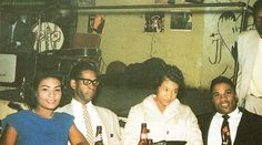 """""""Elmore James with manager Casey Walker and two lady friends"""" [caption in """"Voyage au Pays du Blues""""!] at Charlie's Lounge, 1811 West Roosevelt Road, Chicago, 1959; source: Ace 3 CD set ABOXCD 4 (1993) booklet, p. 23; photographer: Jacques Demêtre"""