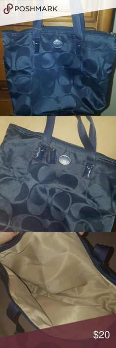 Coach mini tote Navy Blue with small pouch Coach purse. Mini tote with zipper. Approximately 10 inches high and 10 inches wide. Brand new. Also includes small makeup bag / pouch. ( only Pouch was used but still new condition) Coach Bags Satchels