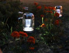 Yard lighting with mason jars... pretty!