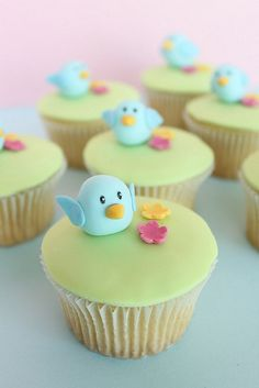 blue bird cupcakes.  pale blue birds and green.  Love them!