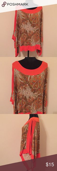 Lane Bryant Top Beautiful spring and summertime Lane Bryant top. It has opening on the sleeves cute design on front. Good condition. Offers welcomed. 95% Rayon 5% Spandex Lane Bryant Tops Blouses