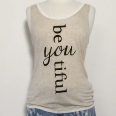April Spirit Sleeveless Graphic Tee Be You Tiful Graphic Tee. Oatmeal color. 96%rayon 4%spandex 🚫trades April Spirit Tops Tank Tops