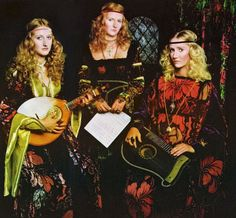 """books0977: """" The Percy Sisters, Lady Caroline, Lady Julia & Lady Victoria playing lyre and lute in """"Renaissance of Costume Splendour"""" for UK Vogue, October 1, 1970. Photographed by Barry Lategan. The Percy Sisters are wearing fashions by Thea Porter..."""