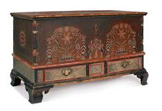 "BERKS COUNTY, PENNSYLVANIA DECORATED BLANKET CHEST, ca. 1780, with floral panels and intricate checkered borders, flanked by corners with columns, above two drawers and ogee bracket feet, 30"" h., 49"" w., 22"" d."