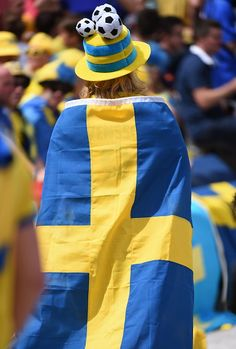 A Sweden walks covered with a Swedish flag before the Euro 2016 group E football match between Italy and Sweden at the Stadium Municipal in Toulouse...