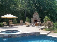 Weddington, NC , outdoor fireplace, raised paver patio by Fine Edge Landscape Design, via Flickr