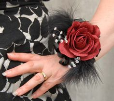 Measurements  Width:- 4 inches  Length:- 7.5  inches (Edge of feathers)    Wrist Corsage from Sarah's Flowers