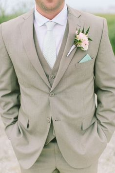 36 Groom Suit That Express Your Unique Styles and Personalities For so long the grooms have been too traditional with their wedding attire, while in 2017 you might see some difference in the groom attire or groom suits. Beach Wedding Groom Attire, Wedding Tux, Groom And Groomsmen Attire, Dream Wedding, Groom Suits, Wedding Ideas, Beach Attire, Wedding Beach, Mens Wedding Attire Summer