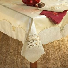 """New - Christmas Bell Design Gold Table Runner by WMU by WMU. $85.88. Please refer to the title for the exact description of the item. Allof theproductsshowcased throughoutare100%OriginalBrand Names.. 100% SATISFACTION GUARANTEED. Christmas Bell Design Oblong Table Runner. Embroidered and applique v-shaped Christmas runners. Measures 16"""""""" wide by 90"""""""" length. Made of 70% polyester and 30% cotton. Hand wash. Imported."""" Sold Individually Please note: If there ..."""