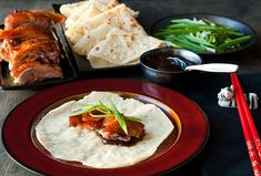 Mandarin Pancakes (Mushu Shells) served folded in quarters with duck, hoisin suace, green onions
