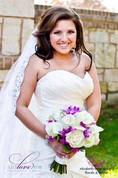 Our smiley bride exudes happiness while carrying a vibrant bouquet on her special day. Elizabeth Wray Design-Geneva,IL Just Love Me Photography