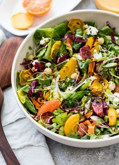 Citrus Salad with Roasted Carrots and Goat Cheese - A fresh and healthy winter citrus salad with roasted beets, carrots, chickpeas, oranges, tangy goat cheese and honey-citrus dressing. #saladrecipes, #cleaneatingrecipes