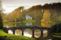 Stourhead - our 18th-century landscaped garden - and one of its enchanting temples featured in the 2005 production of Pride and Prejudice. The Temple of Apollo, set above the tranquil lake, was used as the location for Mr Darcy's first and futile proposal to Lizzie. Afterwards an offended Lizzie makes her exit across the Palladian Bridge. — กับ Ruth Cobb ที่ Stourhead National Trust