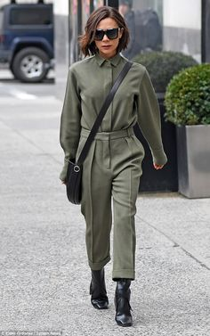 Slinky: The brunette commanded attention in her simple but stylish green jumpsuit, which s...