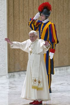 A Swiss guard salutes as Pope Benedict XVI delivers his