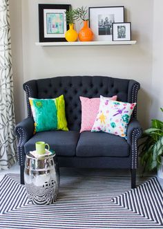 Love this colorful space with custom pillows made from kids art!