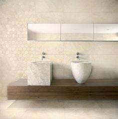 La couleur du carrelage en harmonie avec les lavabos