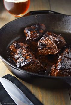 Pan-seared marinated steak tips prepared in a cast iron skillet. The marinade consists of a beer based teriyaki marinade with a subtle spicy kick.