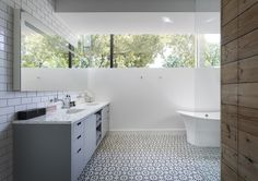 Mosaic house floors: Bathroom of Palma residence in Austin Texas with subway tiles on walls, patterned blue and white tiles on floor and double vanity, by Hugh Jefferson Randolph Architects, Photograph by Whit Preston Shiplap Bathroom, Bathroom Renos, Bathroom Vanities, Bathroom Ideas, Kitchen Sink Window, Austin Homes, Austin Texas, Clerestory Windows, Family Bathroom
