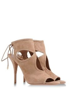 AQUAZZURA peep-toe sandal open at the heel with an interwoven design over the foot and ankle creating a very sexy effect. This shoe will be the focal point of your outfit. Pair with an equally storng mini dress.