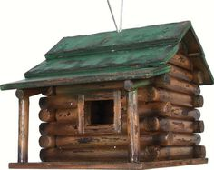 Wood Log Cabin Bird House. This classic hand made rustic wooden bird house will have your feathered friends feeling at home in no time. Sturdy wood construction, heavy duty wire hanger.