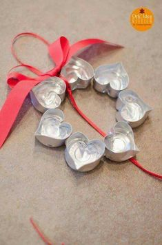 Christmas decorations made from tea light cases shaped into hearts.