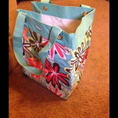 Thirty one daisy craze essentials storage tote bag New, never carried thirty one essentials storage tote in daisy craze. This is a retired hard to find pattern. No spots, or stains. All items are smoke & pet free. 31 Bags Totes