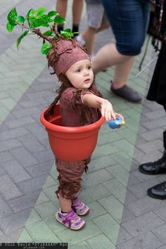 Walking Mini Mandrake A little brown outfit can go a long way when you're dressing up as a magical plant.