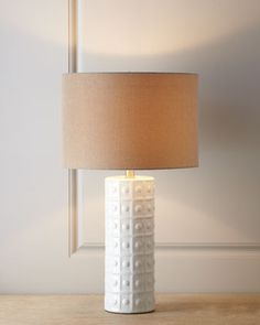 """The base is pretty darn white, but the share is nice - and so is the price at $124.90 and 39"""" tall.    White Ceramic Lamp at Horchow."""