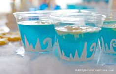 blue hawaiian punch, lemon-lime soda, vanilla ice cream (for the punch) --- white fabric paint with glitter on clear cups