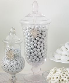 An exquisite candy buffet featuring colors of white and silver. Designed by Elizabeth MacLennan of realsimple.com with candy provided by CandyWarehouse.com.
