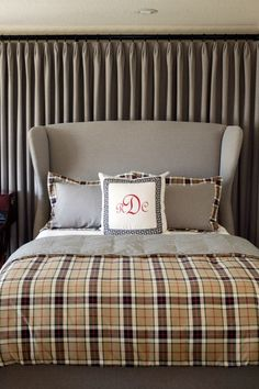 If your bed has to be positioned in front of a window, consider backing it with draperies to camouflage it.