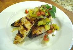 This delicious Grilled Herb Chicken with Pineapple Salsa recipe is a such a reader favorite, it's been revised and simplified to save time, while still tasting AMAZING! Check out the f… Whole 30 Recipes, Clean Eating Recipes, Real Food Recipes, Chicken Recipes, Healthy Eating, Cooking Recipes, Yummy Food, Healthy Recipes, Protein Recipes