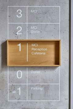 Subtle wayfinding using concrete and wood.
