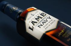 Designed by Davis, exquisite dark, amber and white rum are displayed in hexagon-shaped glass bottles. Beverage Packaging, Bottle Packaging, Brand Packaging, Packaging Design, Branding Design, Liquor Bottles, Vodka Bottle, Glass Bottles, Lambs Navy Rum