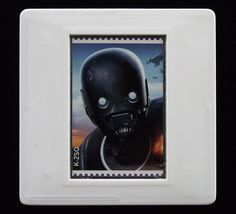 In 2018 the Royal Mail released a set of special stamps featuring some of the favourite droids, aliens and creatures in the 'Star War' films. This 1st class stamp design shows K-2SO (also referred to as K2 or Kay-Tuesso) who first appeared in the 2016 film 'Rogue One'. The unused stamp is encased in a vintage slide mount, with glass, making this a unique piece of jewellery. True Colors, Colours, Presentation Cards, Star Wars Film, K2, Royal Mail, Design Show, Rogues, Postage Stamps