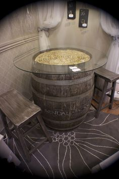 wine barrel table with bar stools for basement rustic elegance