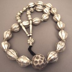 """Silver beads, Nepal     Description     A beautiful antique necklace """"Newar"""" worn by women of the area of Kathmandu ... it is very rare now  and difficult to find and especially as such good quality ... quality of silver, beautiful patina make this necklace a nice collector's item but also a very nice necklace so easy to wear!      Weight:249,1gr    Length:36,22inch"""