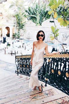 white straps Silk slip dress and ankle heels short straight dark brown hair