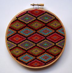 Turkish Rug Cross Stitch Pattern. Beautiful, bright, multi-colored diamonds adorn this cross stitched piece inspired by Turkish rugs.