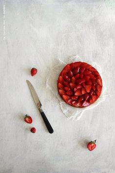 Strawberry Pie: pastry, almond, light vanilla cream and strawberries.