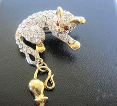 Excited to share the latest addition to my #etsy shop: Kitty Cat Pin, Rhinestones Encrusted, Red Eyes, Mouse Hooked to Tail  Brooch