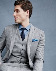 OCT '15 Style Guide: J.Crew men's Ludlow suit jacket, Ludlow suit pant, Ludlow vest, Albiate 1830 for J.Crew Ludlow shirt in deep atlantic chambray, linen-cotton tie in indigo stripe and Italian linen pocket square in paisley.