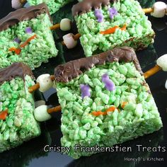 For the Crispy Frankenstein Treats, follow the Rice Krispie Treat recipe, add  green food color when making and dip the crown in chocolate. Draw a face with writing icing and use pretzels and colored mini marshmallows for the bolts.