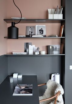 This home office is a beautiful example of a half painted wall - the shelves could be pink to disappear to grey, as they are here, to make a feature.