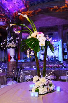 The Fleuriste designed centerpieces with stunning orchids ~ #flowers #white #candles #wedding #party #EventuresInc