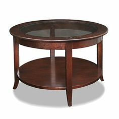 Leick Furniture Favorite Finds Chocolate Oak Round Coffee Table by Leick Furniture. $204.99. Round table in chocolate oak finish. Constructed from quality solid ash wood. Dimensions: 30W x 30L x 19H inches. Features a splayed leg. Bronze tinted glass top with lower display shelf. 10037 Features: -Compact designs keep to themselves.-Bronze tinted glass inset top.-Saber leg.-Solid oak tops.-Softened edges. Color/Finish: -Chocolate oak finish. Assembly Instructio...