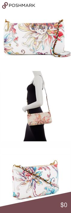 "Floral Demi Clutch Cool textured and glistening prints grace the exterior of a 3-way demi clutch and crossbody for versatile styling. - Detachable shoulder strap- Top zip closure- Interior features 1 media pocket and 1 zip wall pocket- Approx. 6.5"" H x 12"" W x 1.75"" D- Approx. 22"" strap drop - Imported Materials: Exterior Saffiano PU, interior polyester lining Elliott Lucca Accessories"